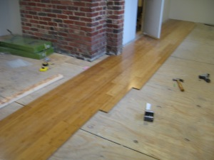 Hardwood floor starts to go down.